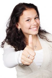 Woman showing thumbs up (photo)
